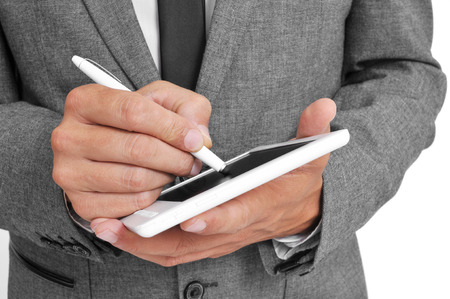 stylus pen: a businessman using a stylus pen in his tablet Stock Photo