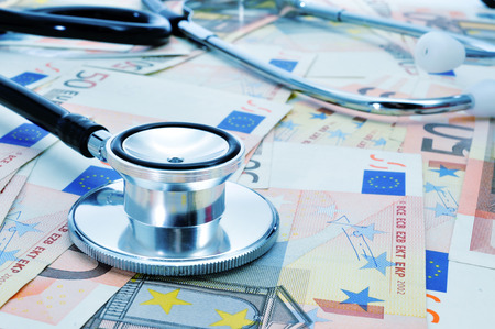 care providers: a stethoscope on a pile of euro bills, depicting the health care industry concept