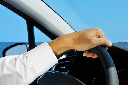 travelling salesman: closeup of a man driving a car