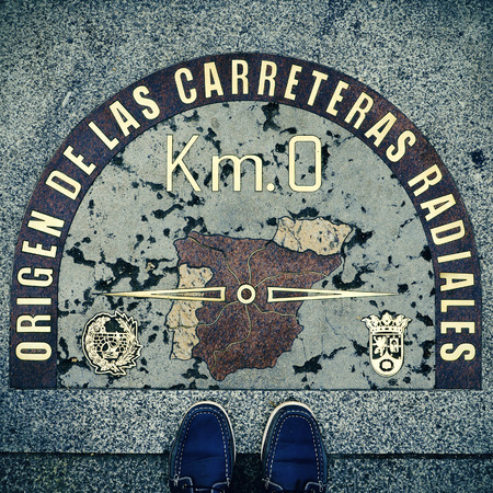 kilometre: stepped on the Kilometre Zero point in Puerta del Sol, Madrid, Spain, with a retro effect Stock Photo