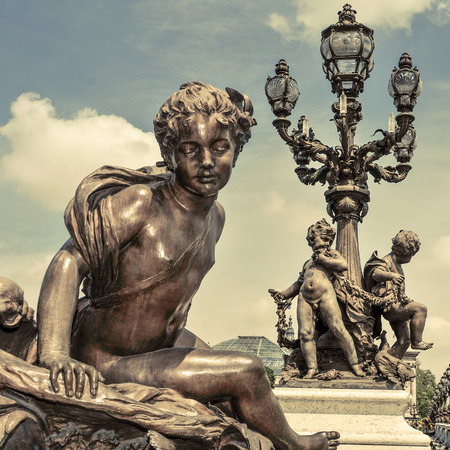 richly: detail of the richly ornamented Alexandre III Bridge in Paris, France, with a retro effect Stock Photo