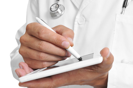 stylus: a doctor using a stylus pen in a tablet