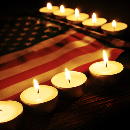 memorial candle: the flag of the United States and lighted candles Stock Photo