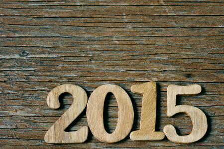 wooden numbers forming 2015, as the new year, on a rustic wooden suface photo