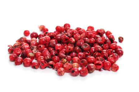 peppertree: a pile of pink peppercorns on a white background