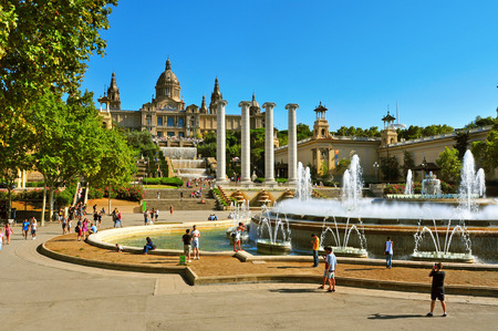 palau: Barcelona, Spain - August 16, 2014: The Magic Fountain and Palau Nacional in Montjuic in Barcelona, Spain. All the area, built for the 1929 International Exposition, is a popular landmark