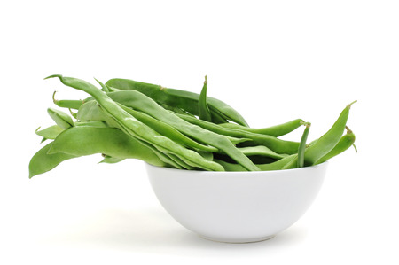 french bean: a bowl with green bean pods on a white background Stock Photo