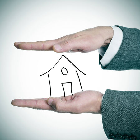 lessee: a businessman holding a drawing of a house in his hands
