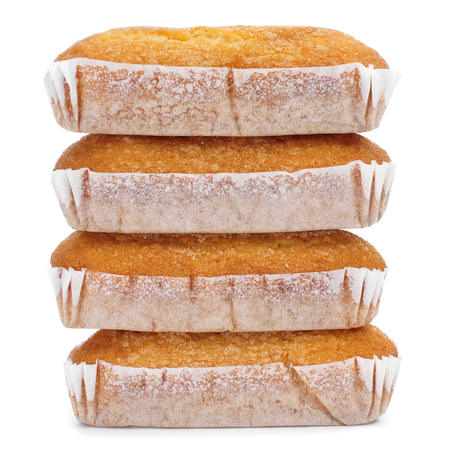 madeleine: closeup of a pile of magdalenas largas, typical spanish plain muffins, on a white background