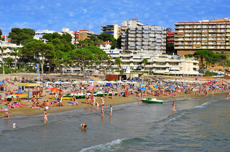 vacationers: Salou, Spain - August 29, 2014: Vacationers in Capellans beach in Salou, Spain. Salou is a major destination for sun and beach for European tourism with more than 50,000 accommodations