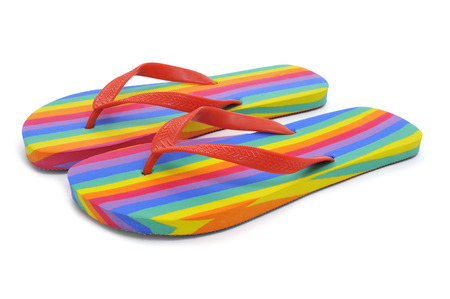 transgender: a pair of rainbow flip-flops on a white
