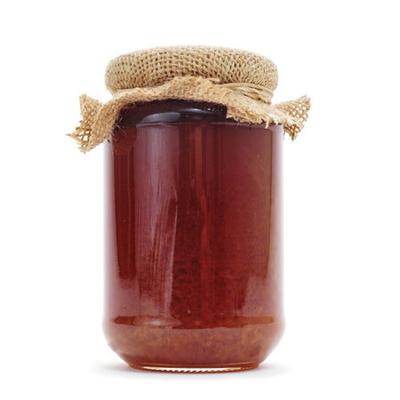 sweeten: a jar of honey on a white background