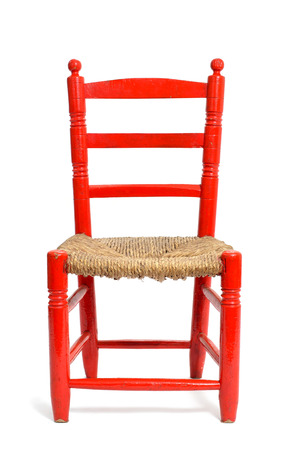 an old red wicker chair on a white background photo