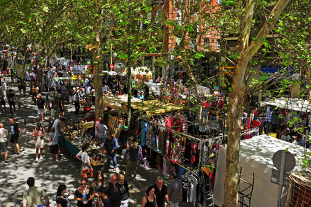 Madrid, Spain - August 10, 2014: Overlook of El Rastro flea market in Madrid, Spain. This popular open air flea market is held every Sunday and public holiday Editorial
