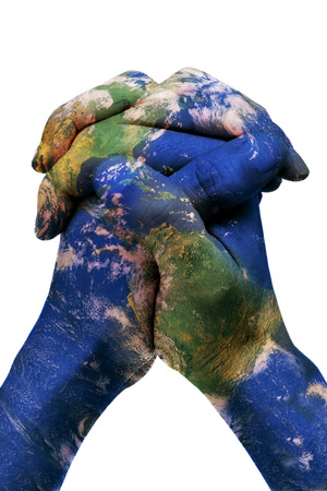a world map in man hands forming a globe  photo