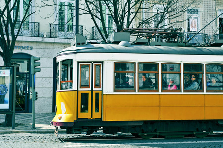 chiado: Lisbon, Portugal - March 18, 2014: A typical yellow tram in Chiado district in Lisbon, Portugal. The tramway is the most popular mode of transport used by locals and tourists both