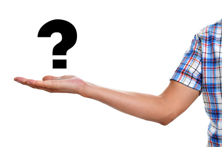 existentialism: the hand of a young man holding a question mark on a white background Stock Photo