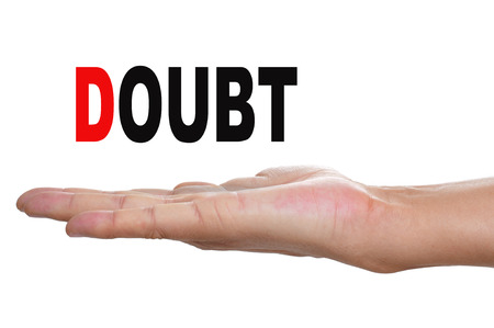 existentialism: the hand of a man holding the word doubt on a white background