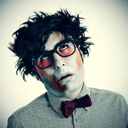 a hipster zombie wearing a bow tie and glasses photo