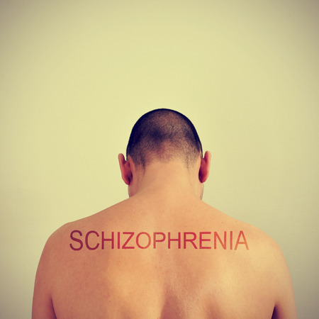 psych: portrait of the back of a young man and the word schizophrenia