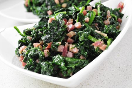 sautee: closeup of a bowl with spanish espinacas con jamon, spinach with ham Stock Photo