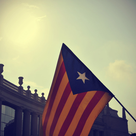 separatism: the estelada, the Catalan pro-independence flag, against the sky with a retro effect