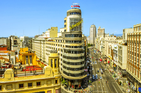 gran: Madrid, Spain - August 11, 2014: Aerial view of the Gran Via in Madrid, Spain. Gran Via is known as the Spanish Broadway because is the location of the most important theaters in the city