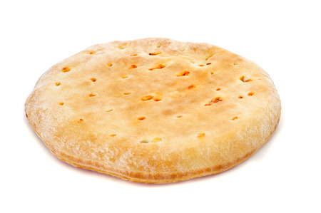 closeup of an empanada gallega, a savory stuffed cake of Galicia, Spain, on a white background