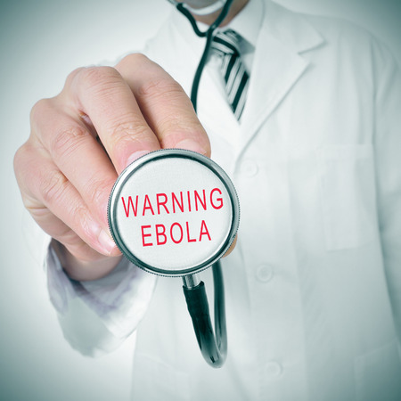 epidemiology: doctor with a stethoscope with the text warning: ebola written in it