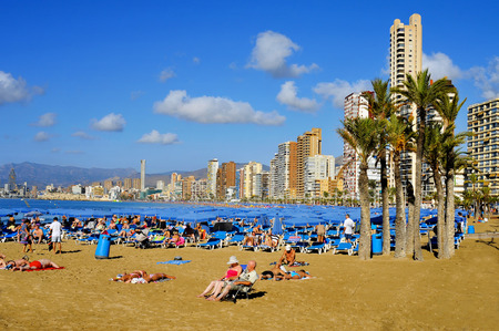 Benidorm, Spain - September 23, 2014: Vacationers in Levante Beach in Benidorm, Spain. Benidom, called sometimes Beniyork, is a major destination for sun and beach for European tourism