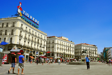 Madrid, Spain - August 11, 2014: People walking in Puerta del Sol square in Madrid, Spain. This popular pedestrian square is one of the busiest place in the city