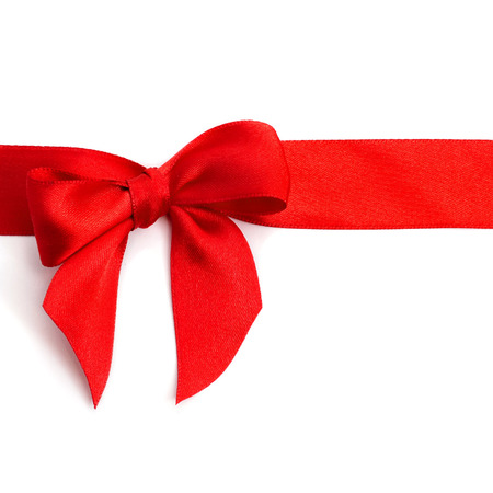 a red ribbon with a bow on a white background with a blank copy-space
