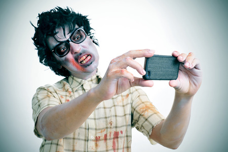 a scary zombie taking a selfie of himself with a smartphone, with a filter effect