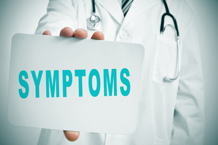 geriatrician: a doctor showing a signboard with the word symptoms written in it