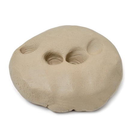 clay modeling: a dough of self-hardening modelling clay on a white background