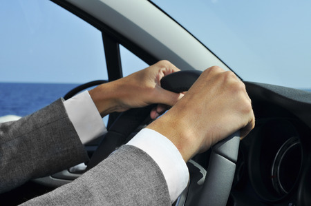 valeting: closeup of a man in suit driving a car