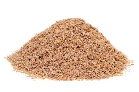 a pile of wheat bran on a white background Stock Photo