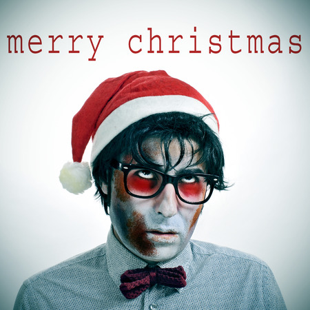 the sentence merry christmas and a hipster zombie wearing a bow tie and glasses and a santa claus hat photo
