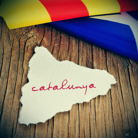 separatist: a piece of paper in the shape of Catalonia with the word Catalunya