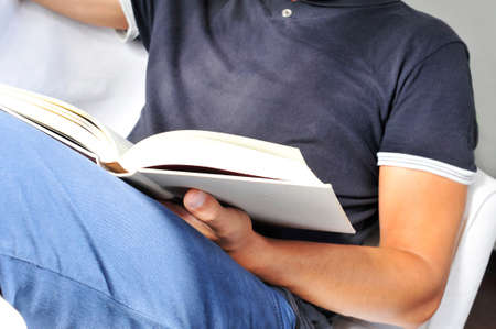 a young man reading a book photo