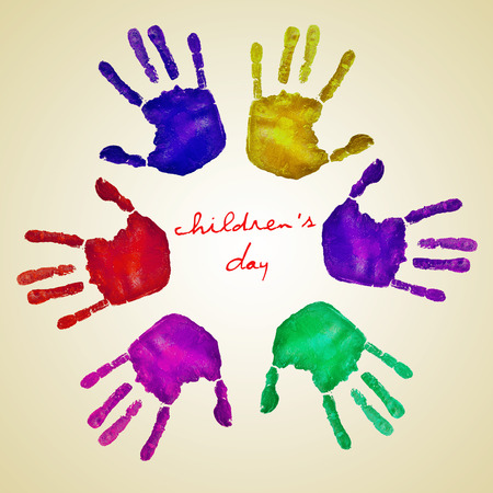 handprints: handprints of different colors forming a circle and the text childrens day written in the center on a beige background