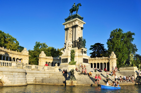 parque del buen retiro: Madrid, Spain - August 10, 2014: People sitting at the Monument to Alfonso XII in Parque del Retiro in Madrid, Spain. This public park is the main park and the most popular in the city