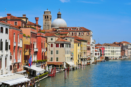 Venice, Italy - April 13, 2013: View of the Grand Canal from Ponti degli Scalzi bridge in Venice, Italy, with the belfry and the dome of the Chiesa di San Geremia church in the background
