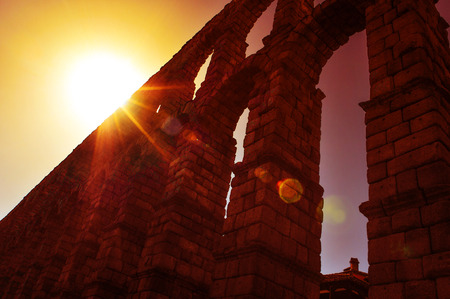 acueducto: a view of the Roman Aqueduct of Segovia, Spain, with backlight and a sunbeam