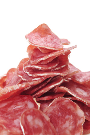llonganissa: closeup of some slices of fuet, spanish cured sausage typical of Catalonia, on a white background