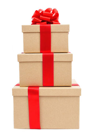 a pile of gift boxes tied with red ribbon on a white background photo