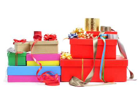 a pile of different boxes, ribbon and ribbon bows of different colors to prepare gifts, on a white background photo
