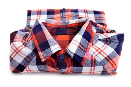 a folded lumberjack shirt on a white background photo