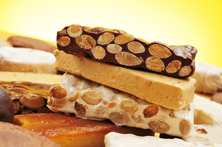 confections: closeup of a tray with different turron, polvorones and mantecados, typical christmas confections in Spain Stock Photo