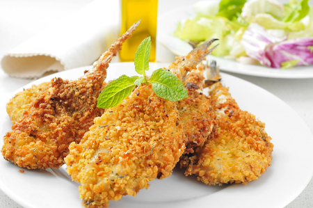 hake: closeup of a plate with some breaded and fried hakes
